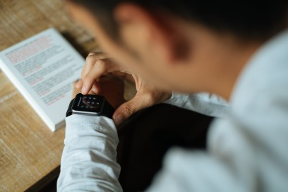 Man in White Dress Shirt Using Black Smart Watch