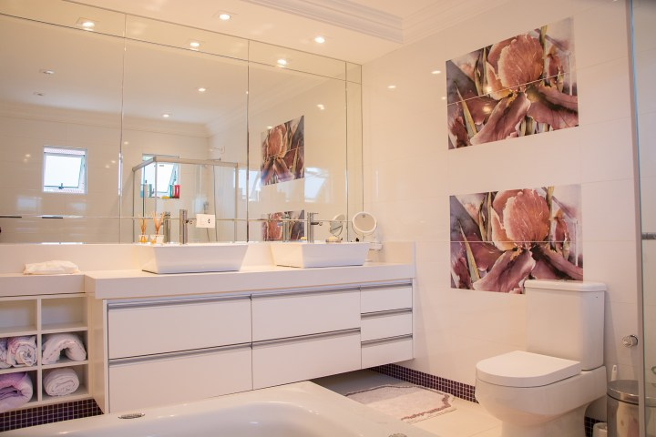 Photograph of a bathroom with mirrors,
