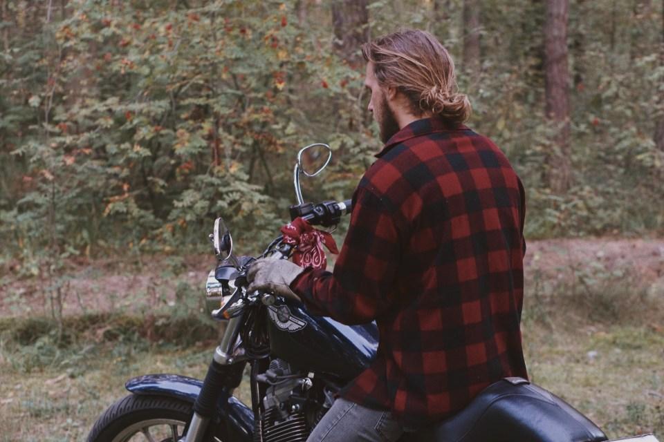 Man Riding on Motorcycle