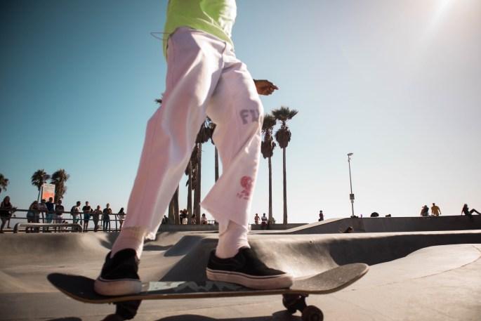 Man Riding on Skateboard Deck