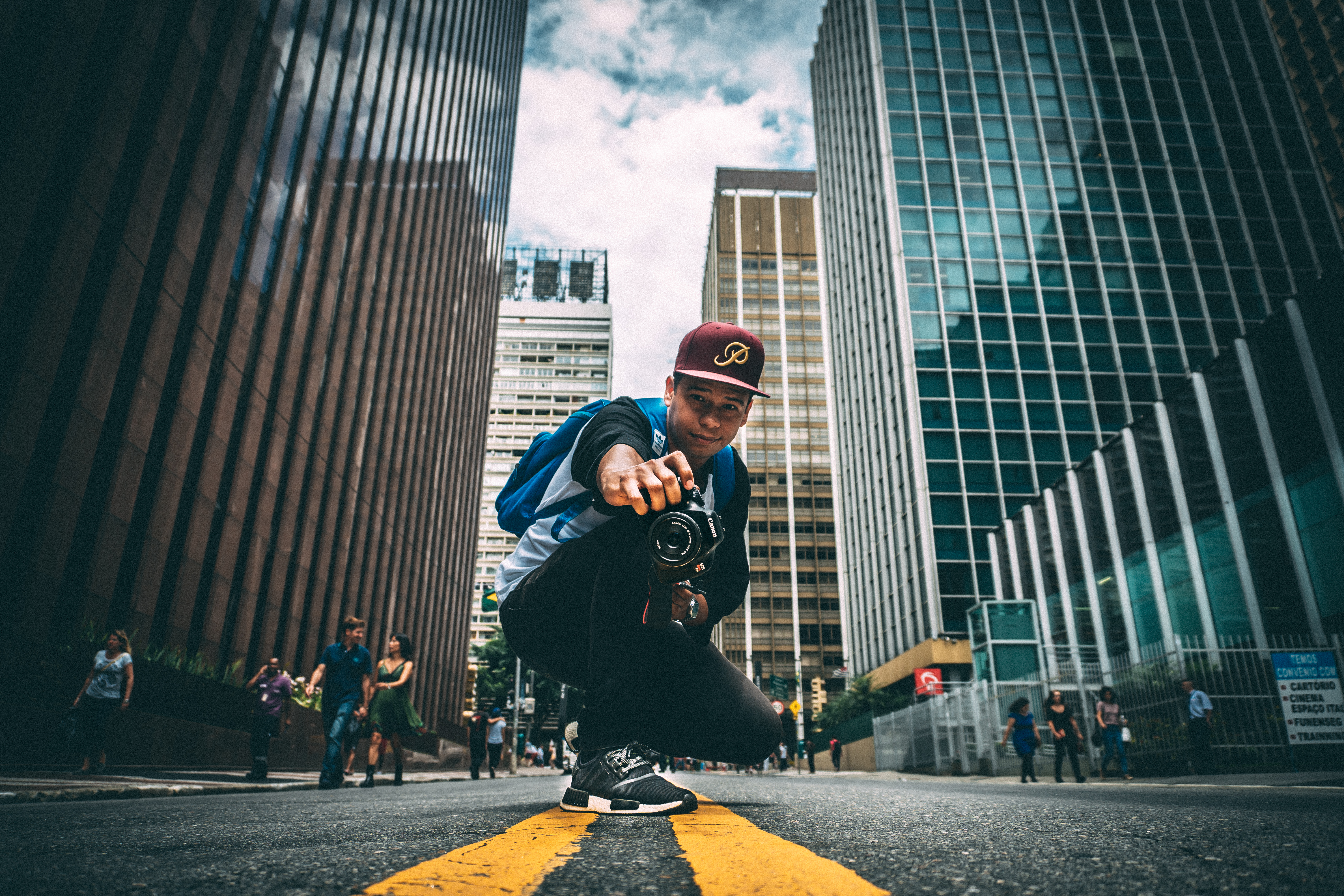 International student on skateboard in city enjoying study abroad