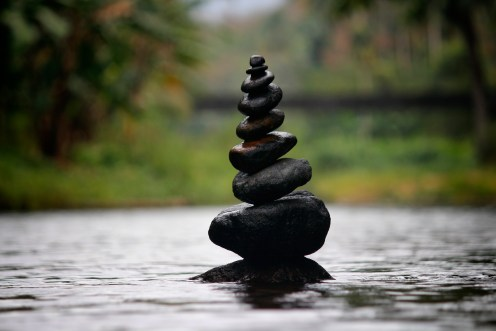 Black Stackable Stone Decor at the Body of Water