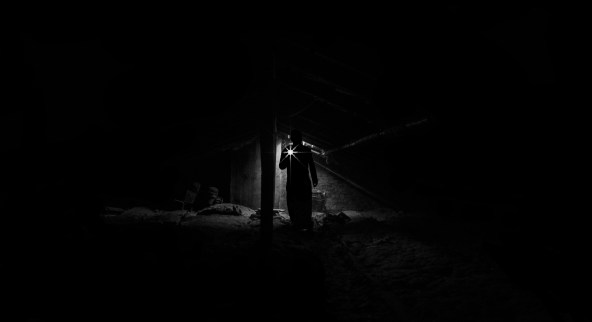 Low Angle View of Man Standing at Night