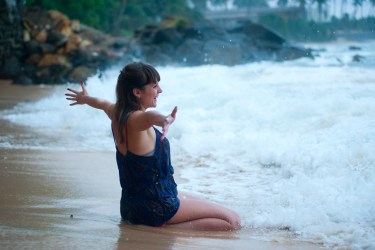 Woman Kneeling on Shoreline, self-love