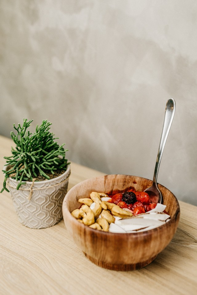 Sliced Berries and Cashews in Wooden Bowl