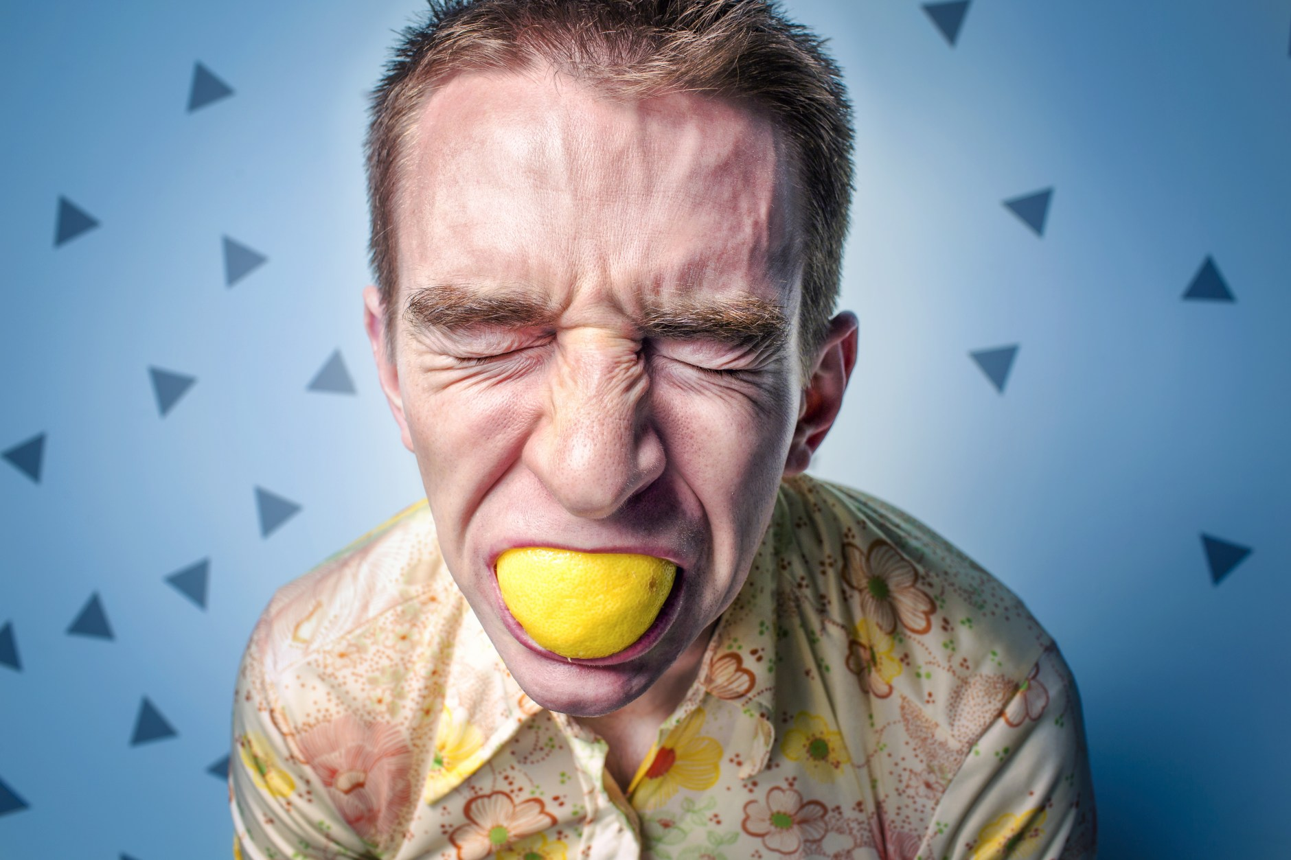 person eating lemon