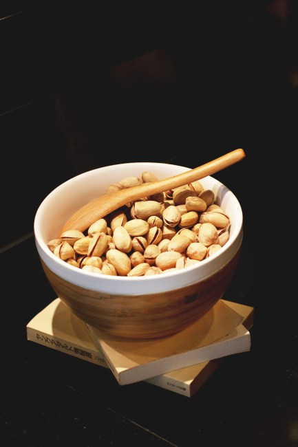 Pistachio Nuts in White and Brown Ceramic Bowl With Brown Wooden Spoon