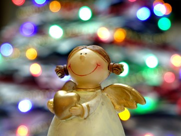 Bokeh Shot of White and Gold Ceramic Angel