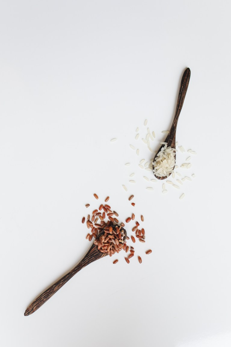 Photo Of Assorted Rice Grain On Wooden Spoon