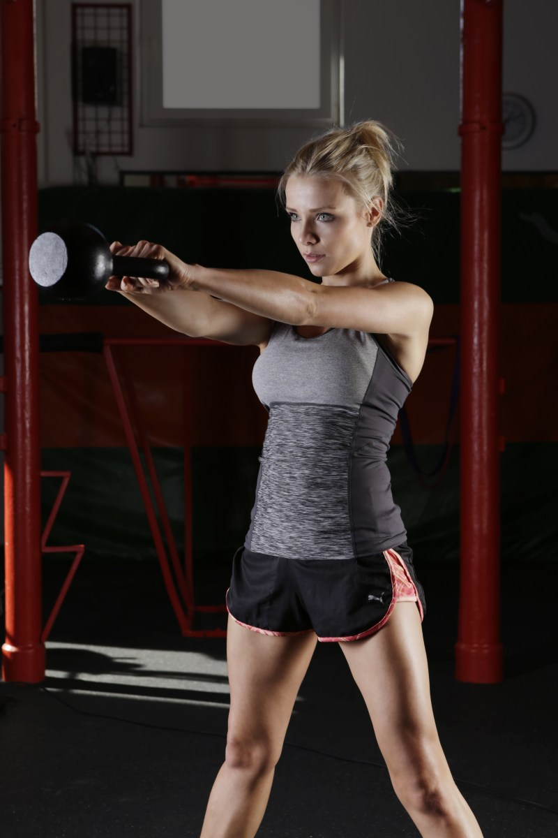 Woman Holding Exercise Equipment