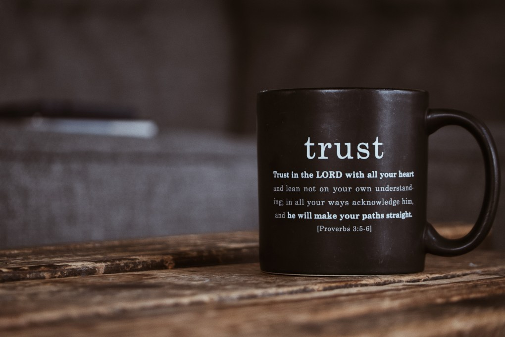 Black mug with religious text from Holy Bible
