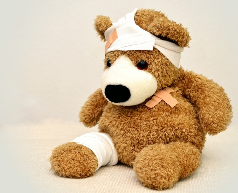 Teddy bear with bandages, first ad