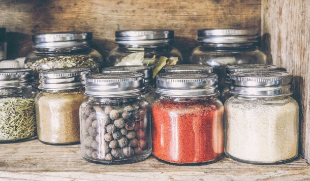 spice jars in a wooden cabinet
