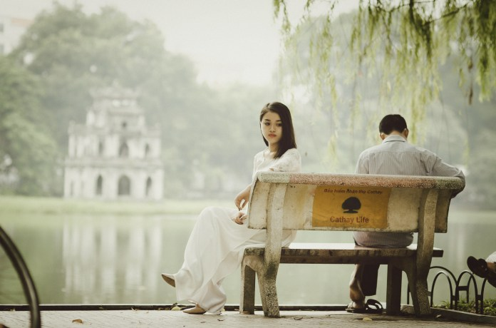 Woman Sitting on Bench Outdoors