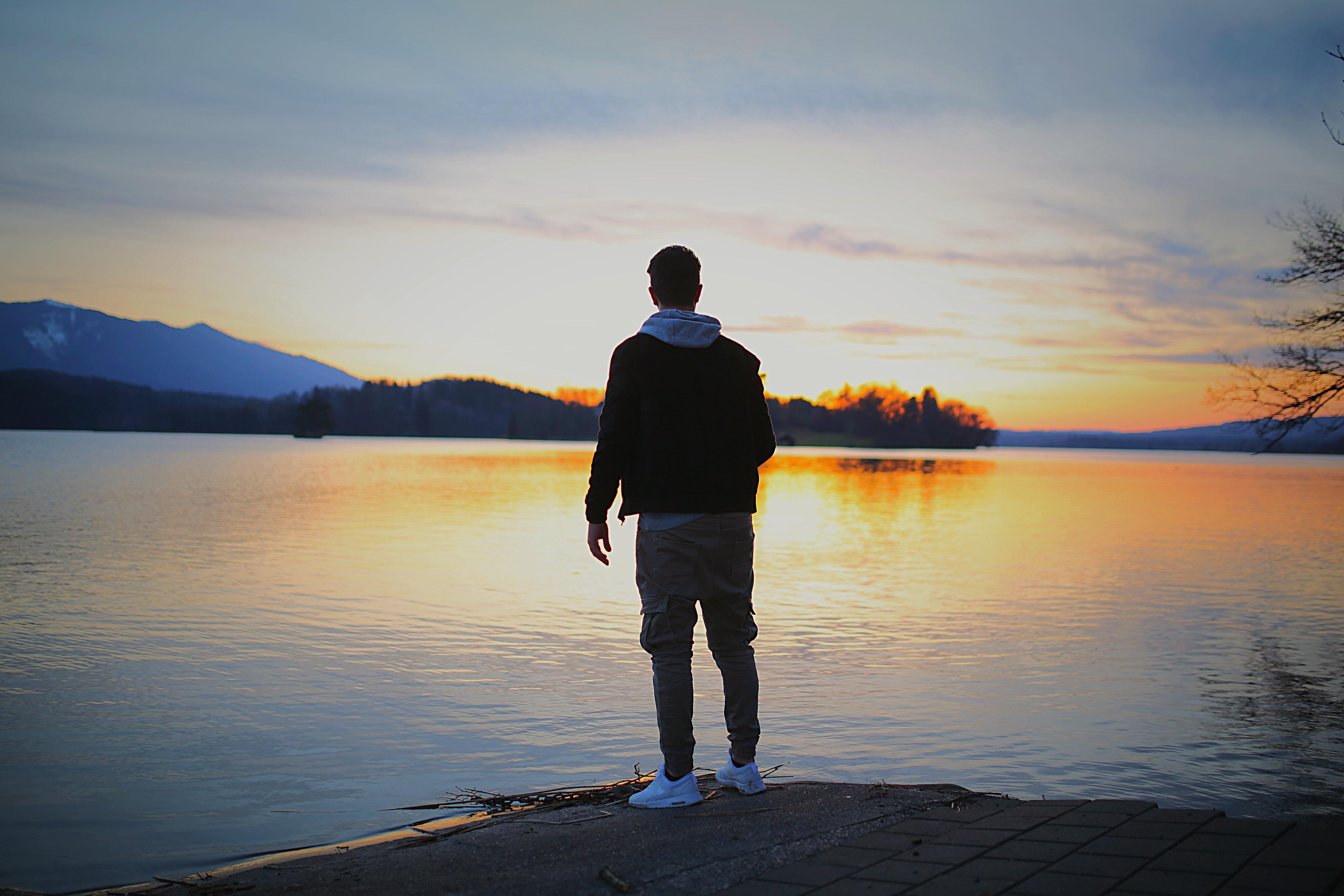Man Standing on White Concrete Surface  Free Stock Photo