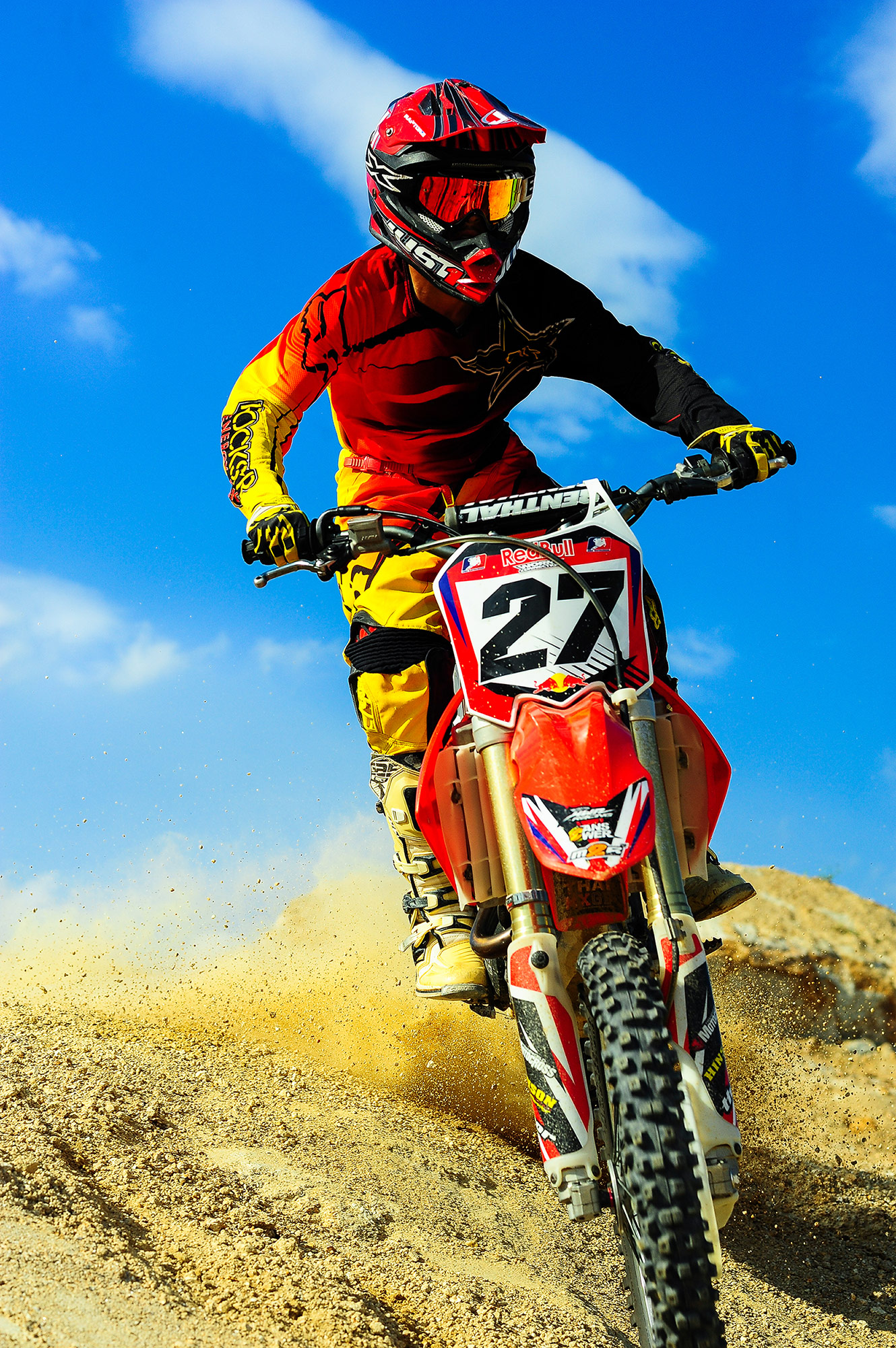 The Cross Hd Wallpaper Man In Blue Motorcycle Suit Riding On Yellow Dirt