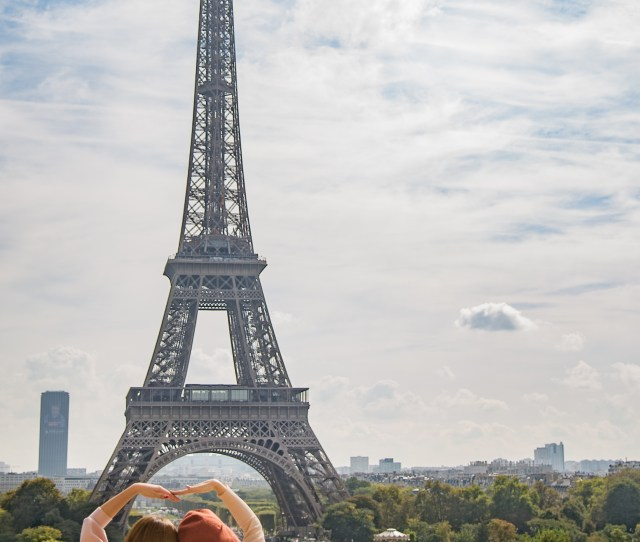 Photo Of Two Women Posing In Front Of Eiffel Tower Paris France During Day