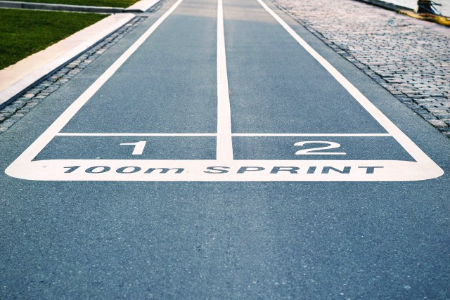 Blue Concrete Pavement With 100m Sprint Paint