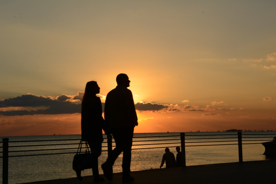 Man and Woman Silhouette Walking during Sunset  Free