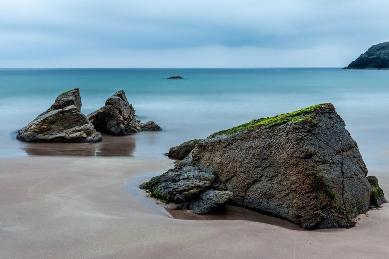 3 Brown Boulders on Seashore during Daytime