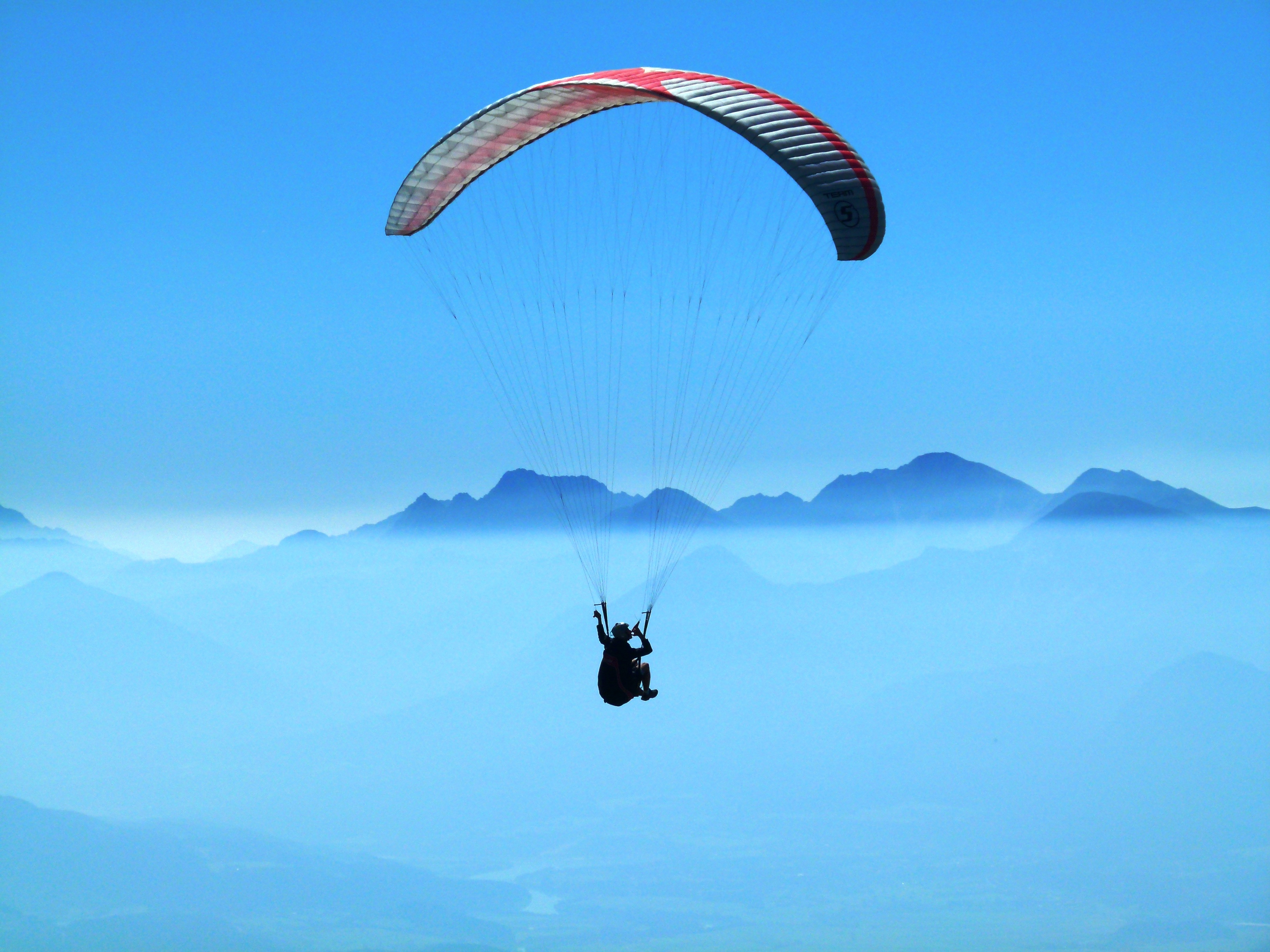 Red Car Wallpaper Download Person Using Red Parachute On Mid Air 183 Free Stock Photo