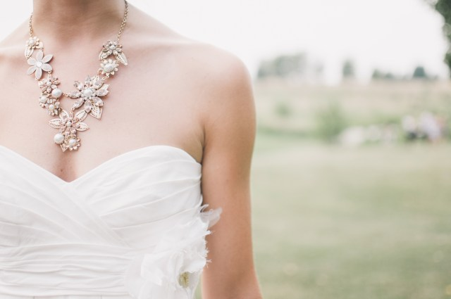 Woman in White Dress Wearing Gold Chunky Necklace during Daytime