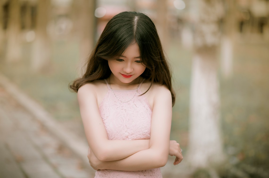 Shallow Focus Photography of Woman in Pink Dress