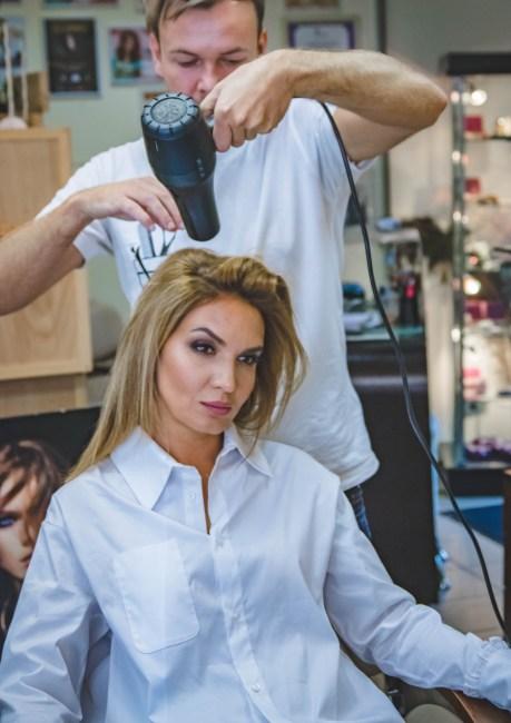 Man Drying Womans Hair  Free Stock Photo