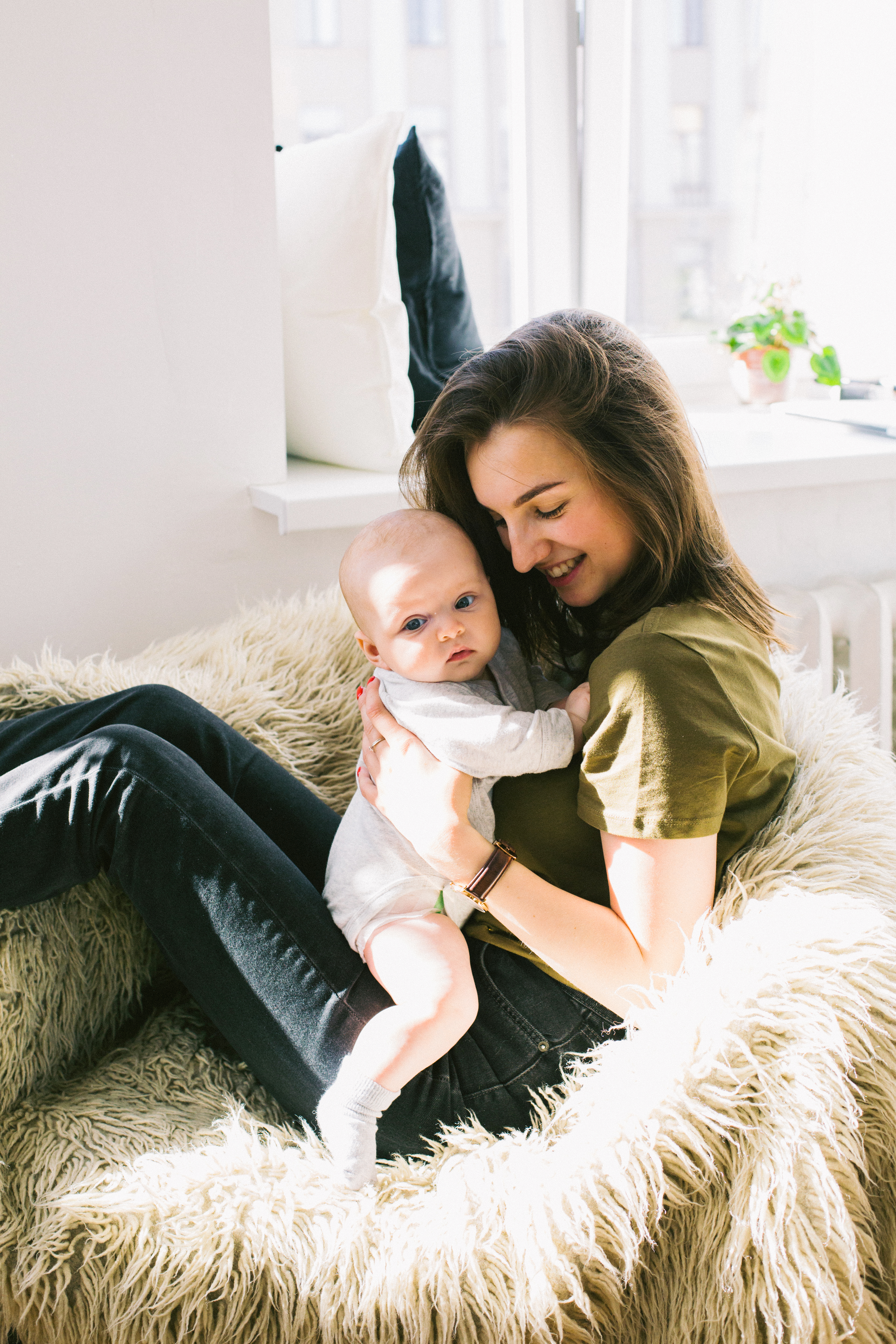Cute Small Girl Wallpapers For Facebook Woman Holding Baby While Sitting On Fur Bean Bag 183 Free