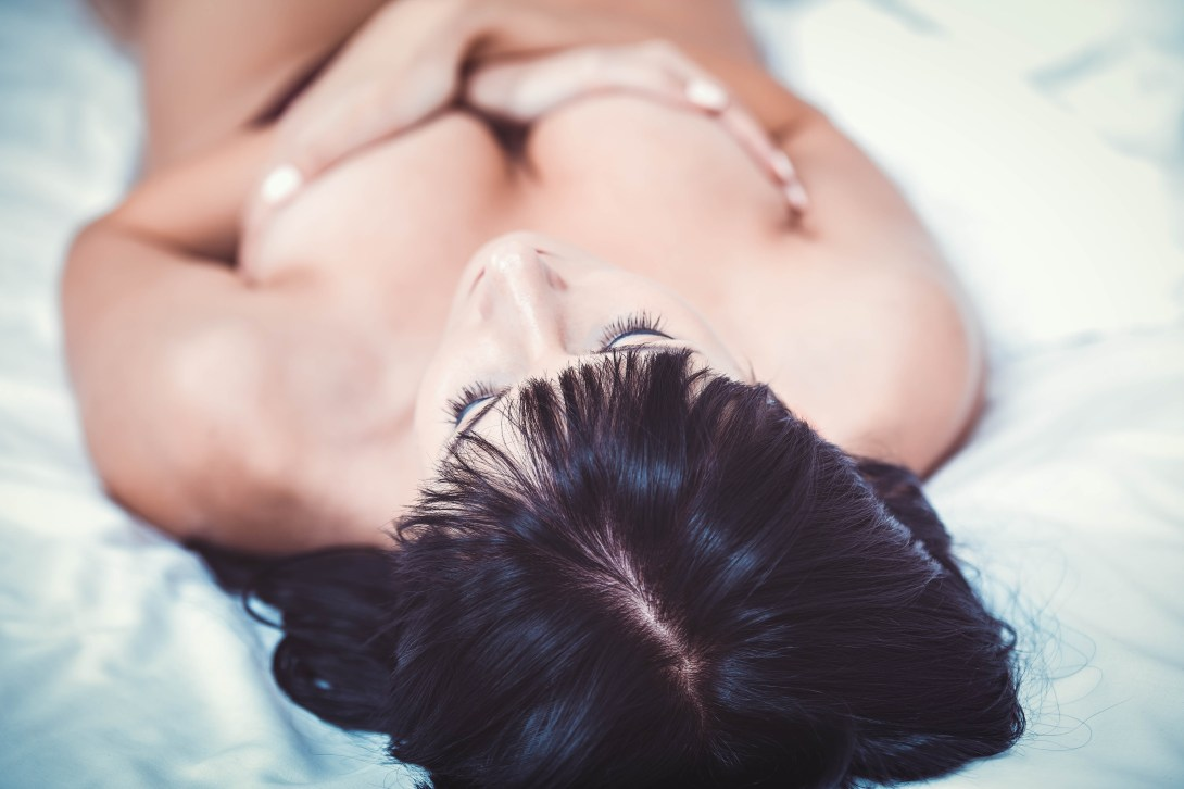 Naked Woman Laying in Bed