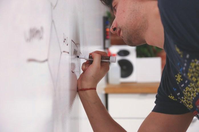 Man Drawing on Dry =erase Board
