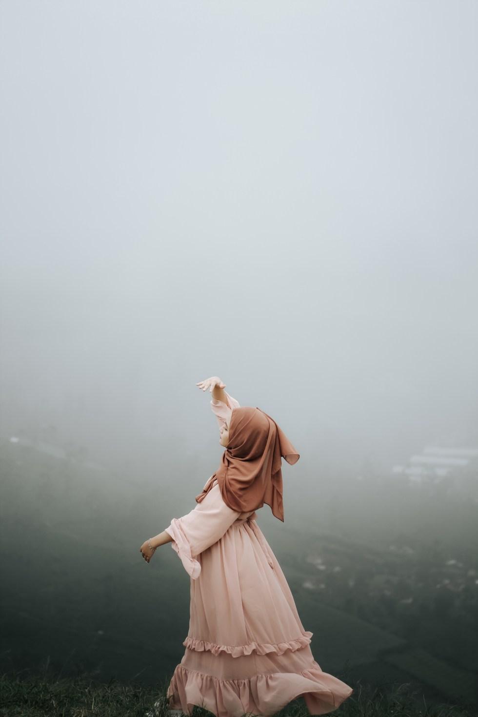 Woman in Pink Dress Standing on Foggy Environment