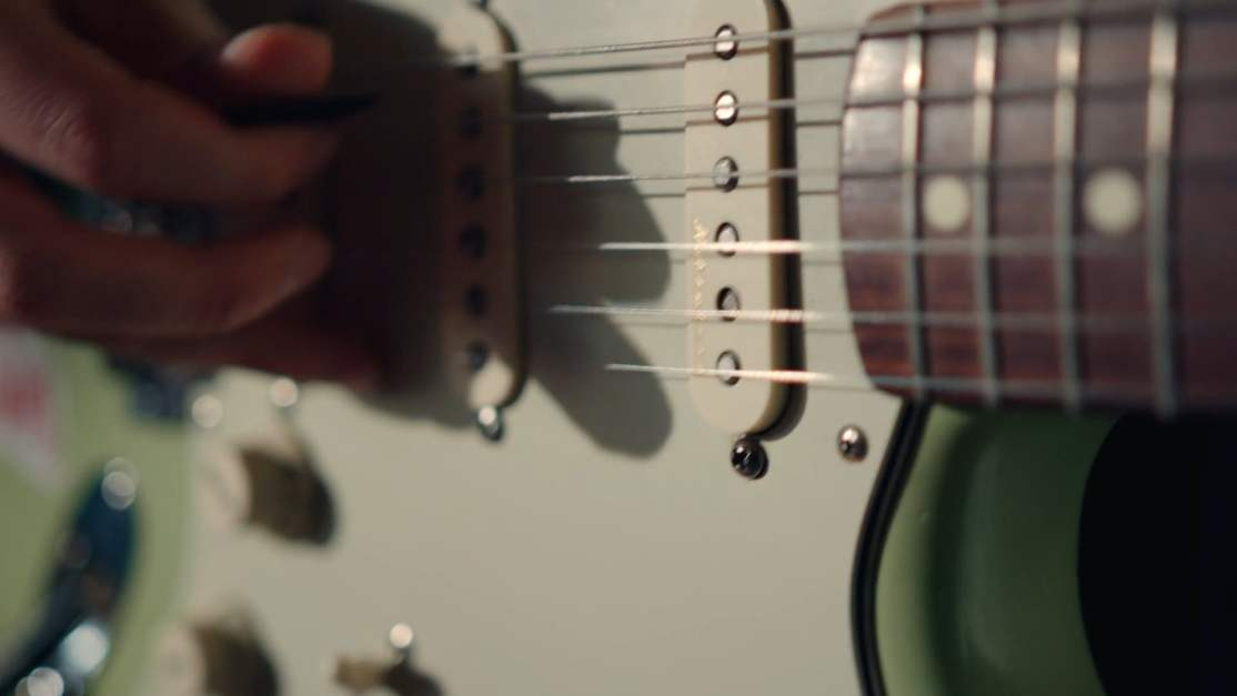 Using A Pick To Play The Guitar · Free Stock Video