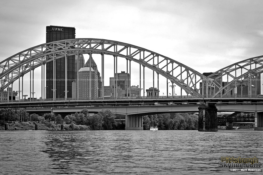 Black and white city of Pittsburgh with the 16th street bridge from the Allegheny River