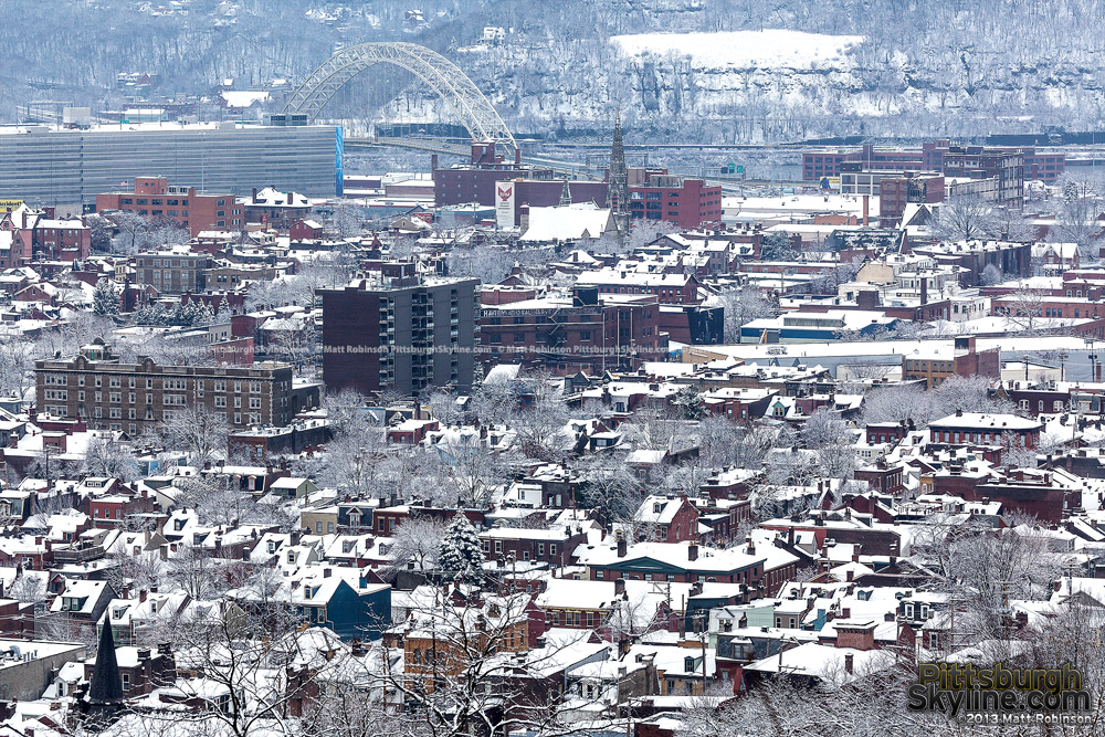 Snowfall on the Northside rooftops
