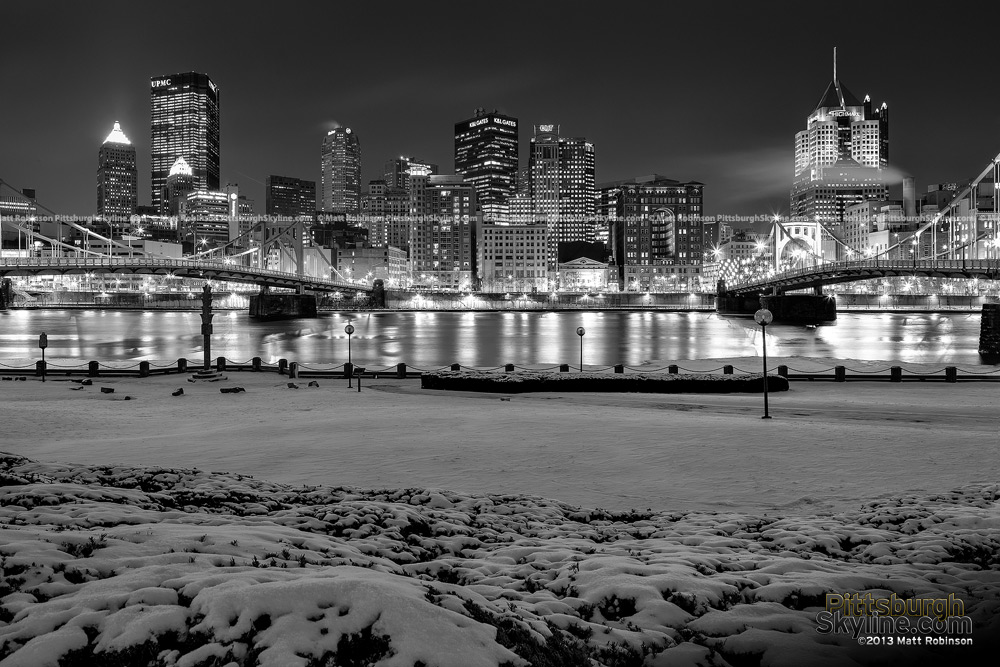 Black and White Pittsburgh Skyline with snowfall at night