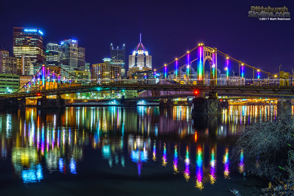 Rainbow colors on the Rachel Carson Bridge reflect in the Allegheny River