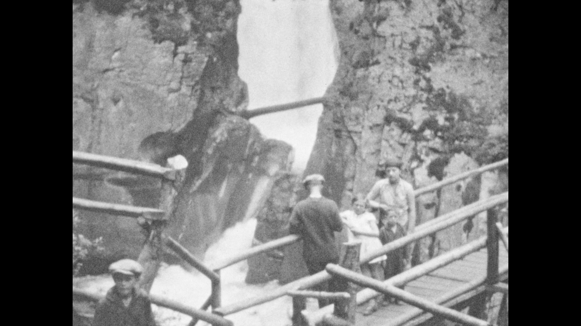 hight resolution of 1920s waterfalls drop below men woman boy and girl on wood bridges
