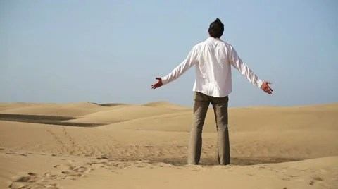 Man With Wide Open Arms Standing On The Desert HD Video