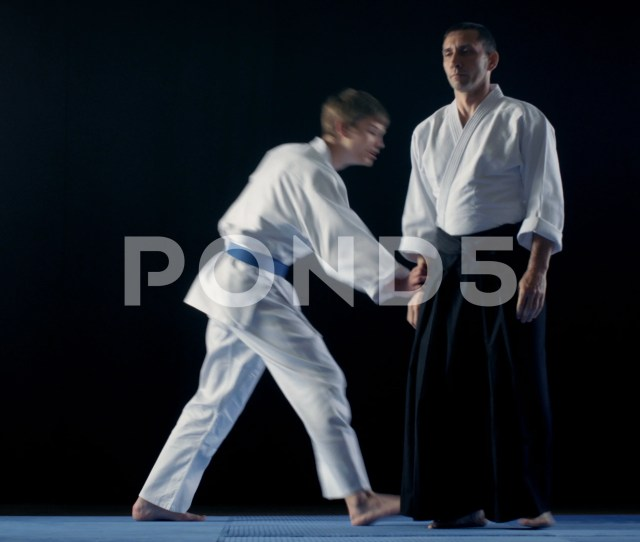 Martial Arts Aikido Master Wearing Hakamas Teaches His Young Student Fight Footage