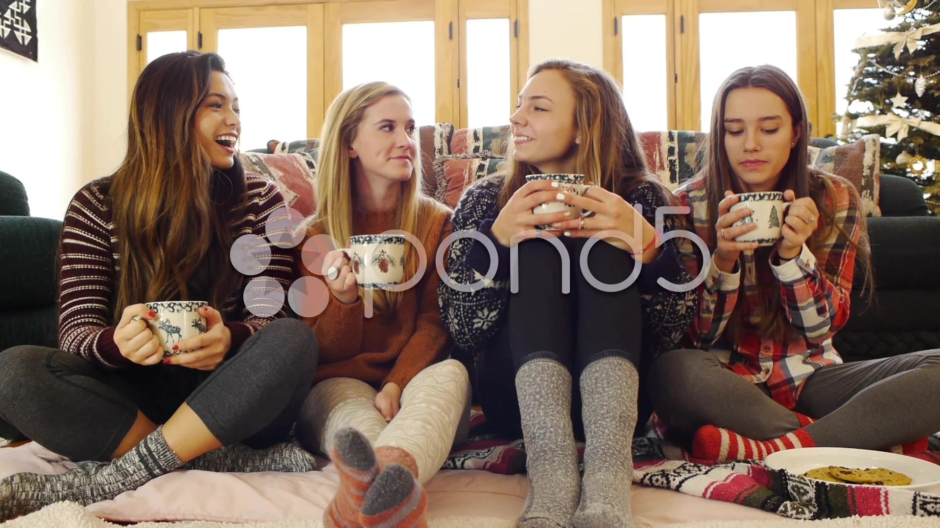 Multi Ethnic Group Of Teen Girls Laugh Over Hot Choc Cookies Christmas Tree Clip 034403042