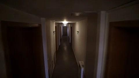 Old Dark Corridor Hallway In Apartment Building Tracking To