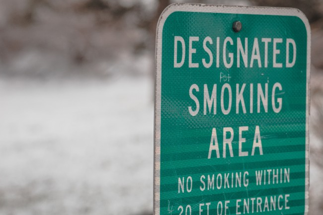 A sign that says Designated smoking area