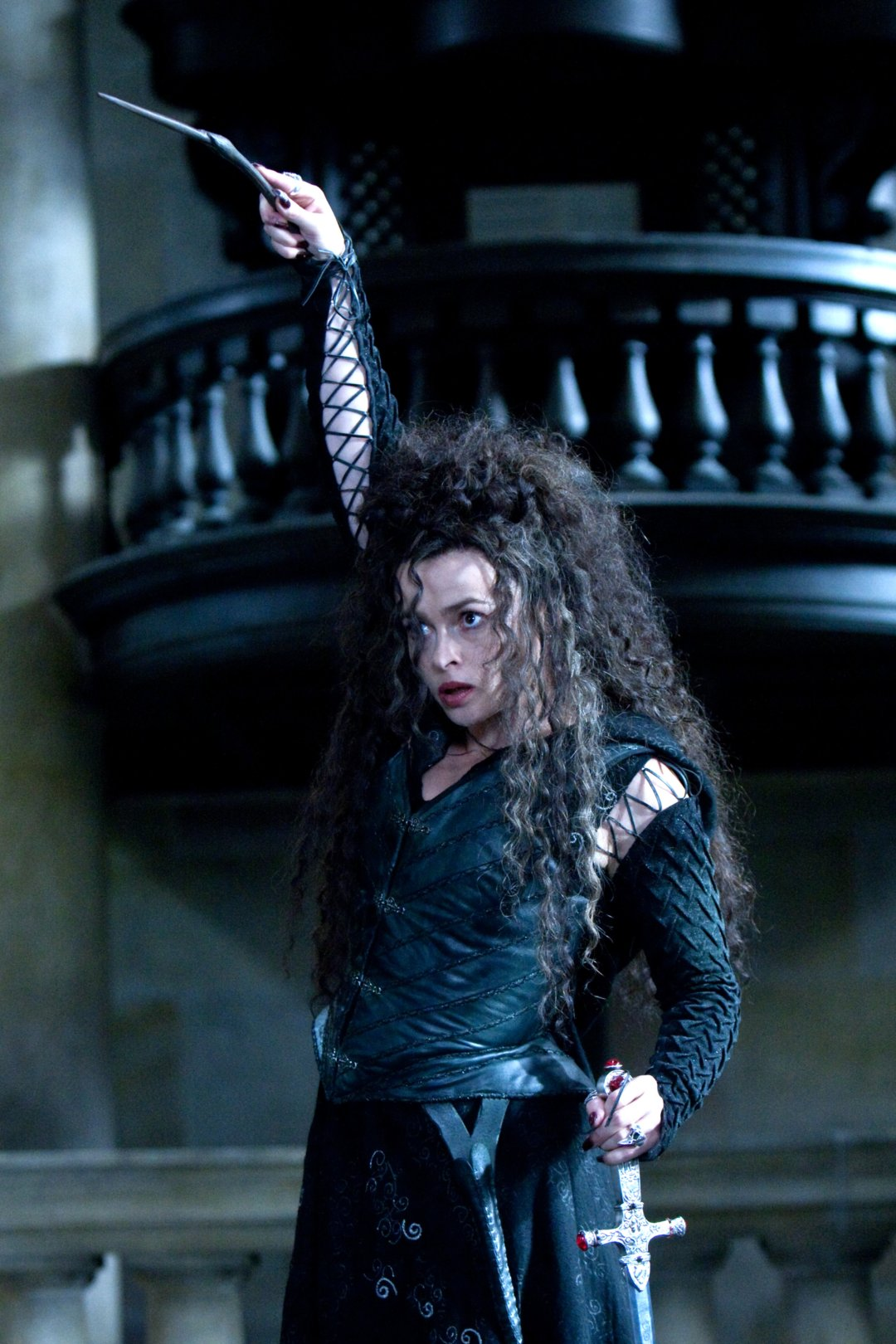 Bellatrix casting a spell and holding the Sowrd of Gryffindor