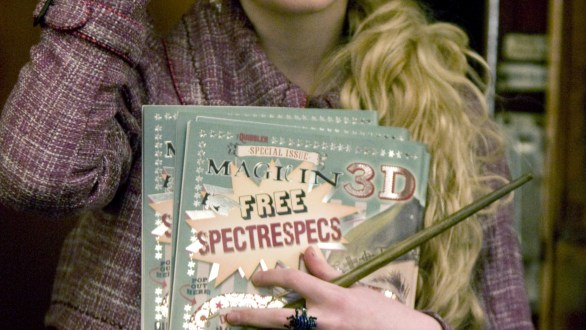 Luna with her Spectre Specs holding the Quibbler