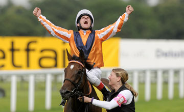 ASCOT, ENGLAND - JULY 21: Andrasch Starke riding Danedream win The King George VI and Queen Elizabeth Stakes at Ascot racecourse on July 21, 2012 in Ascot, England. (Photo by Alan Crowhurst/Getty Images)