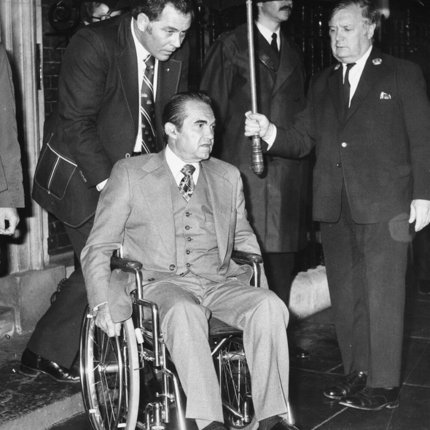 Photo from 1975 showing Alabama Governor George Wallace, in a wheelchair, outside the residence of British politician Margaret Thatcher.