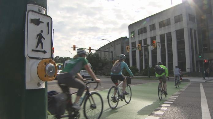 Cyclists cross the street in Vancouver