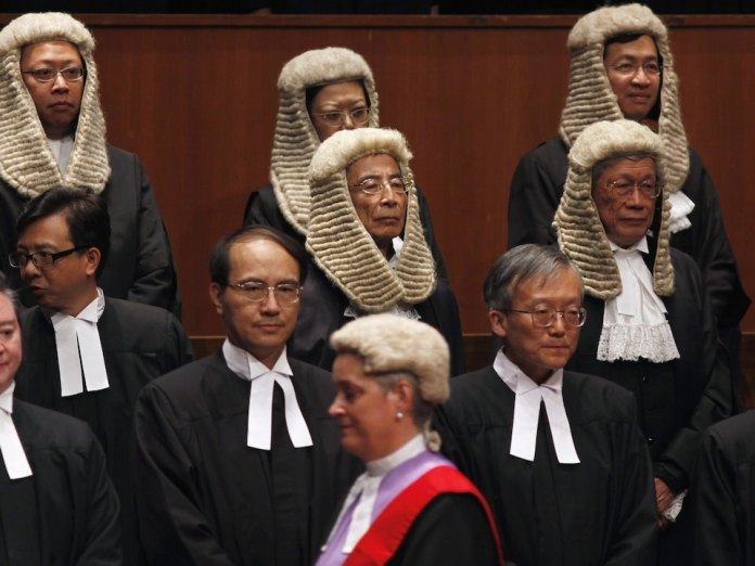 Lawyers wear the toga and the wig.