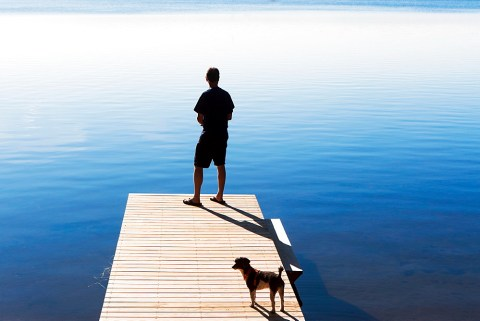 Rear view of man on jetty looking at view, USA, New York State, Wurtsboro